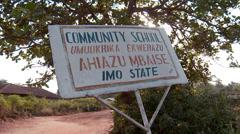Sign 'Community School'  in rural Nigeria Stock Footage