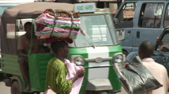 Man selling fabrics by the road, Nigeria - stock footage