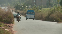 Road with traffic rural Nigeria Stock Footage