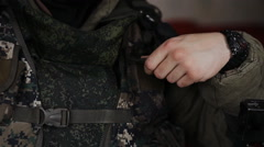 Military puts it in his pocket Vest radio Stock Footage
