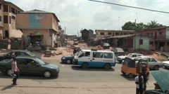 Traffic and street scene in Nigerian town Stock Footage