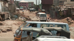 Stock Video Footage of Bad road and traffic in Nigerian town