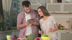 Couple in love reading news on the tablet Stock Footage
