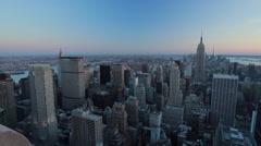 New York City Manhattan buildings skyline evening pan - stock footage