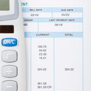 Stock Photo of Neat calculator and utility bill next to it
