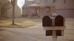 Couple checks mailboxes in early morning sunlight 4K Stock Footage
