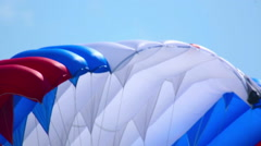 Paratrooper with the flag landing, celebration of Aviator's day airshow Stock Footage