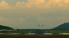 Jet airplane touch down the runway in dusk, telephoto lens - stock footage