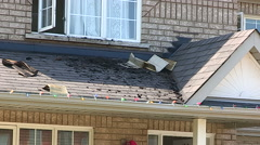 Lightning strike and fire burn damage to house roof Stock Footage