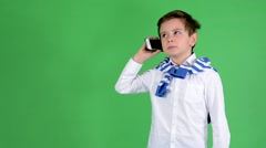 Young handsome child boy phone with smartphone - green screen - studio Stock Footage
