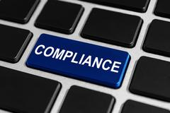 compliance button on keyboard - stock photo
