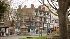 Tudor Architecture and a double decker bus Stock Footage