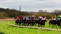 Horses race around track Stock Footage