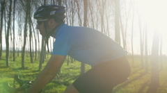 Stock Video Footage of cyclist man rides bicycle close up slow motion