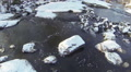 Slow flight over stones in  winter stream. Aerial top view Footage