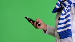 Young child boy works on mobile phone - green screen - closeup - studio Stock Footage