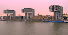 Kranhaus buildings afterglow afterlight sunset Cologne Koln Germany Rhine river Stock Footage