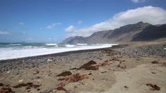 Spain Canary Islands Lanzarote Famara Beach - popular surfing beach Stock Footage