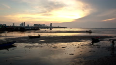Fishing mud flats village with cityscape sunset time-lapse Stock Footage