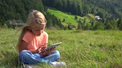 Stock Video Footage of 4K Child Playing Typing Tablet in Park, Little Girl Using Ipad PC, Camping