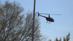 Small Helicopter Taking Off From Parking Lot Stock Footage