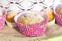 Mini cupcakes in colorful wrapper. - stock photo