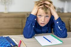 Boy needs help with his homework Stock Photos