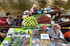 Floating market food sellers - stock photo