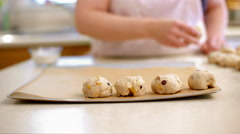Placing hot cross buns on baking sheet in part slow motion 4K Stock Footage