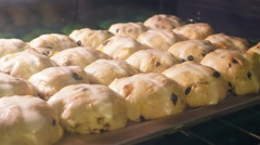 Time lapse of hot cross buns rising in oven 4K Stock Footage