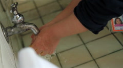 CLOSE UP. Children whasing their hands in the  washbasin in the kindergarten. Stock Footage