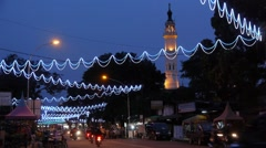Traffic in evening with mosque,Medan,Sumatra,Indonesia Stock Footage