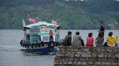 Passengers waiting for ferry boat,Lake Toba,Sumatra,Indonesia Stock Footage