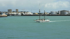 New Zealand Auckland harbour ketch motors in front of Silo Park  Stock Footage