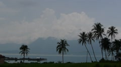 Palm trees and clouds and lake,Lake Maninjau,Sumatra,Indonesia Stock Footage