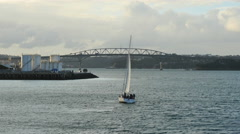 New Zealand Auckland sloop leans heading toward bridge 4k 12 Stock Footage
