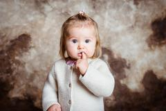 Close-up portrait of cute blond little girl with big grey eyes Stock Photos