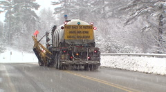Snow plowing in winter snow storm Stock Footage