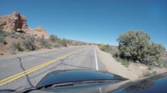 A timelapse of driving by balancing rock in Arches National Park Stock Footage