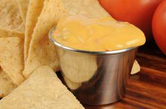 Corn chips and cheese sauce Stock Photos