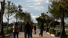 People walking on promenade in afternoon spring Stock Footage
