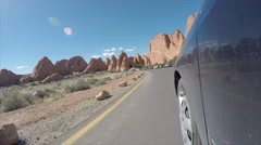 A timelapse exterior shot driving in Arches National Park Stock Footage