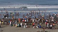 Crowds of people on beach,Pangandaran,Java,Indonesia Stock Footage