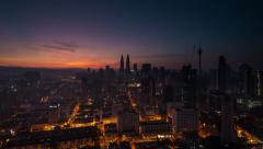 Kuala Lumpur Sunrise Time-lapse with Petronas Towers and KL Tower Visible Stock Footage