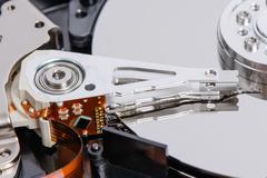 closeup of disassembled Hard disk drive. - stock photo