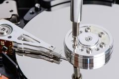 disassemble Hard disk drive - stock photo