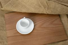 white espresso cup on a wooden plate - stock photo