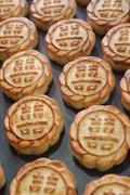 Fresh mooncakes on a baking pan Stock Photos