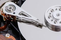 Closeup of disassembled Hard disk drive. Stock Photos
