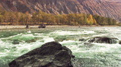 Fast moving River - pan right to left Stock Footage